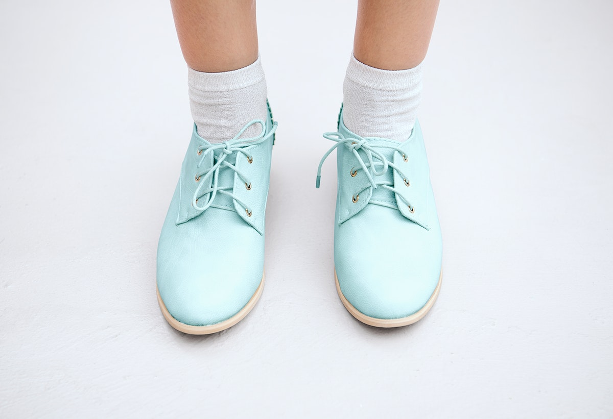 Woman in a pastel blue oxford shoes