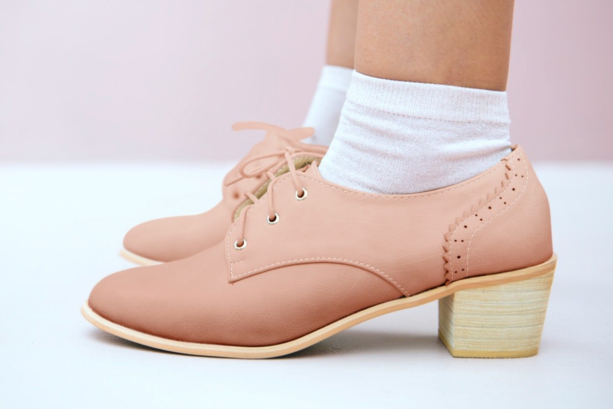 Woman in a nude pink oxford shoes