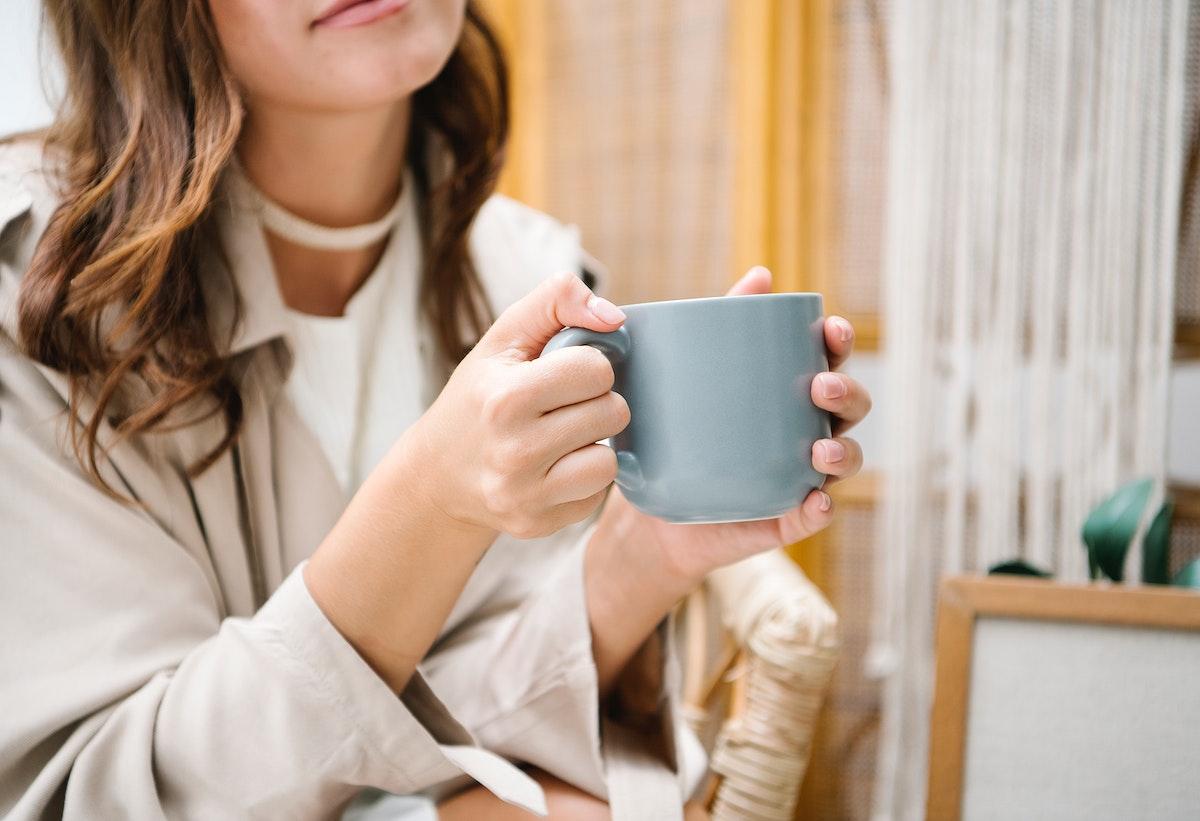 Cheerful woman enjoying her cup of coffee