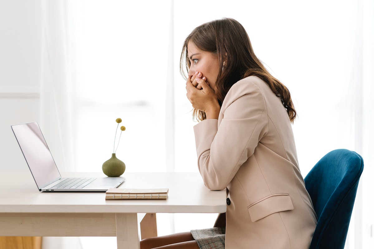 Depressed businesswoman overwhelming with her work