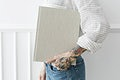 Tattooed woman holding a book mockup