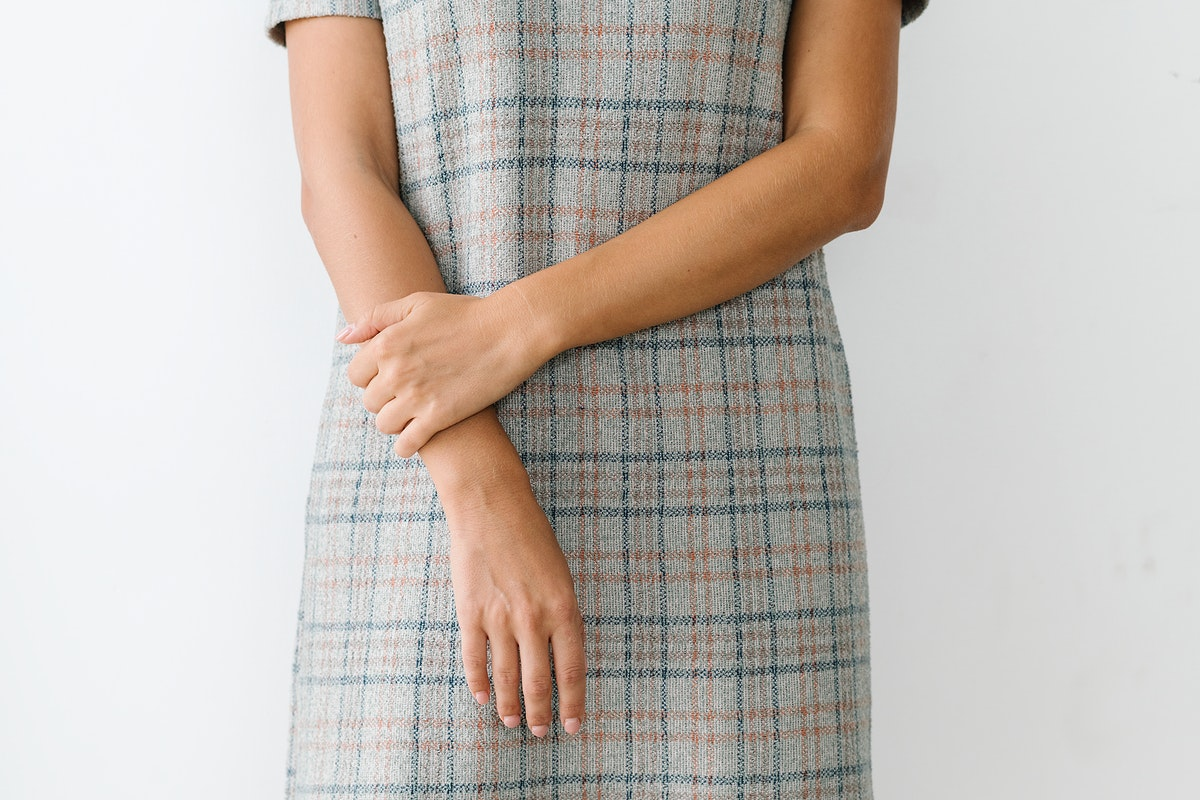Well mannered woman wearing a plaid dress