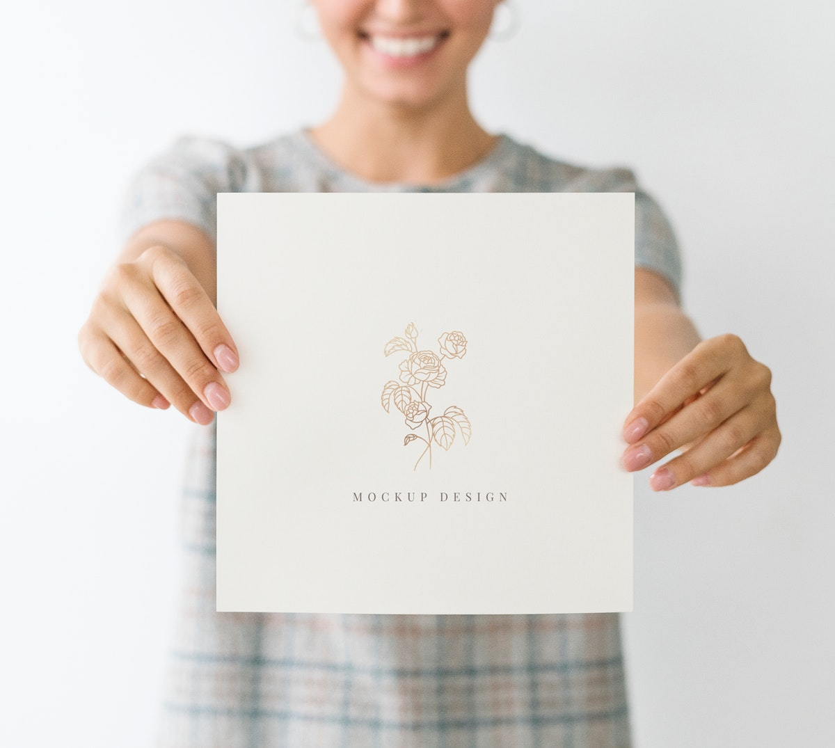 Cheerful woman showing a white card mockup