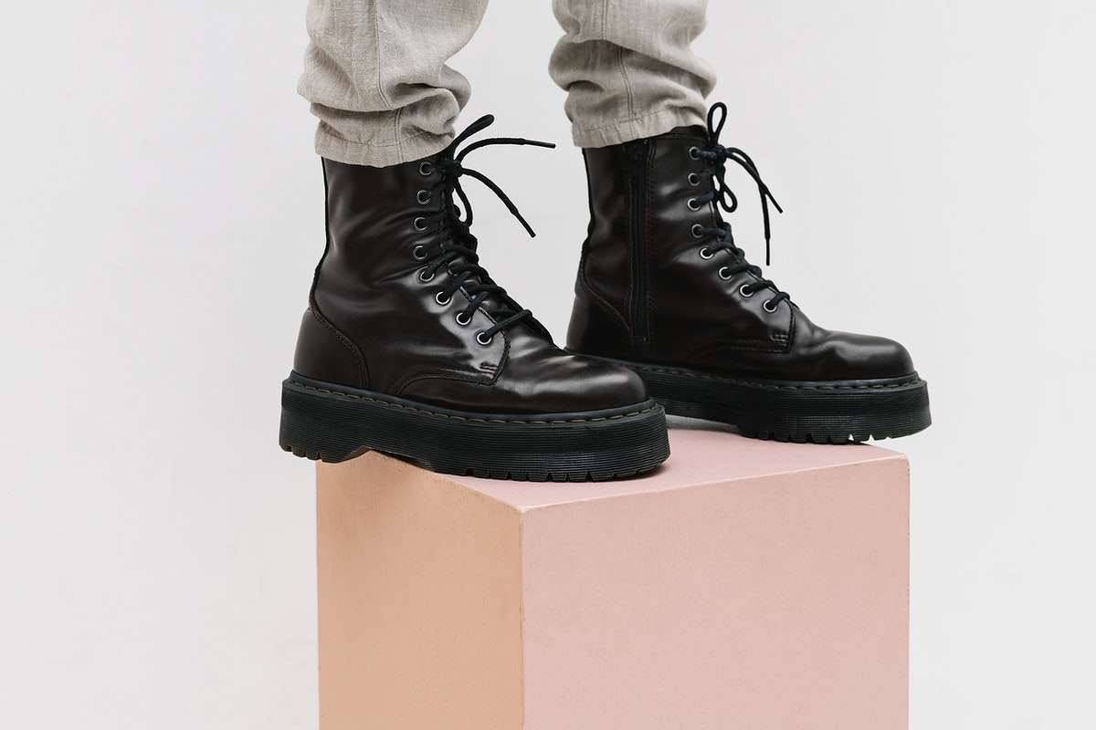 Woman in a black combat shoes