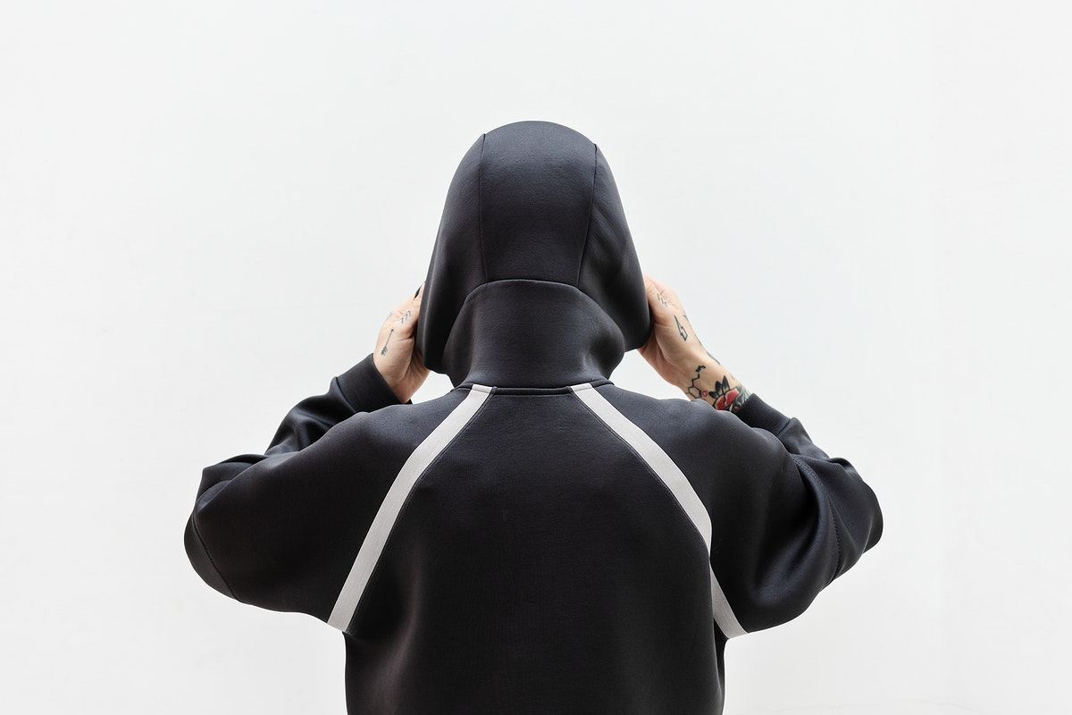 Rearview of a woman covering in a black hoodie