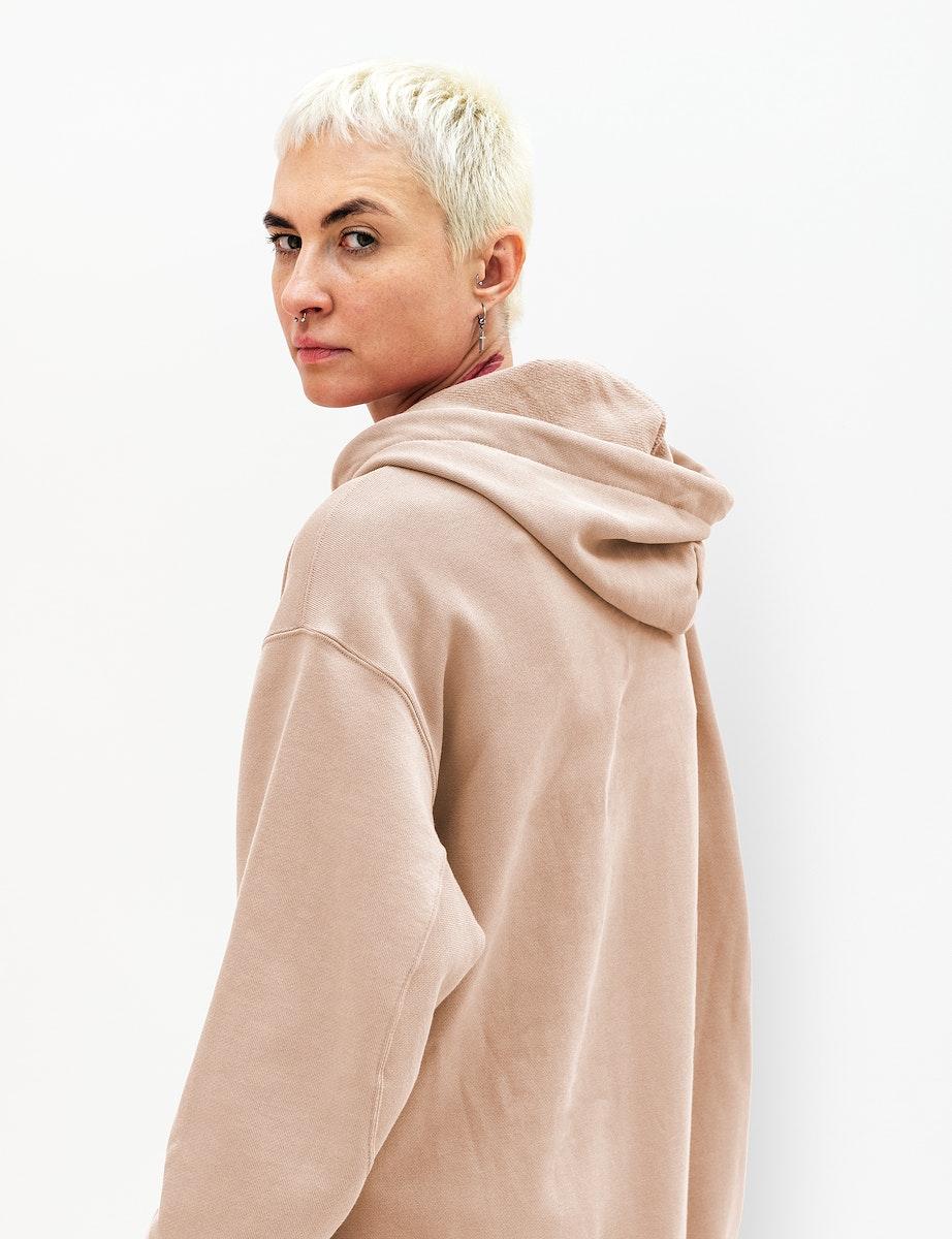 Cool woman in a beige hoodie