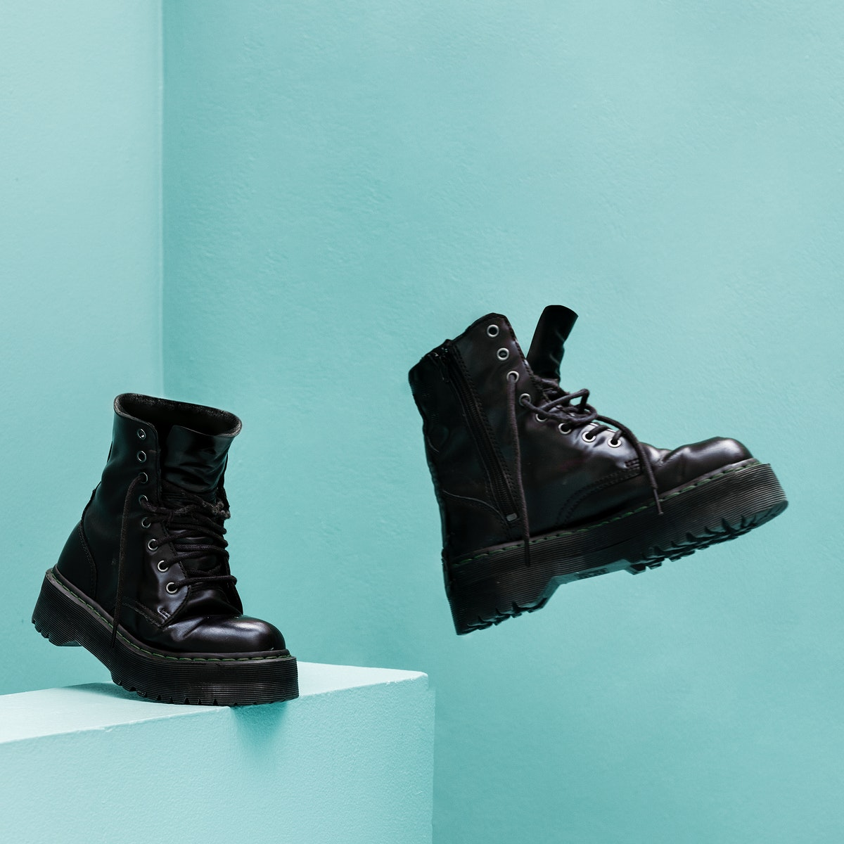 Cool combat boots with blue background