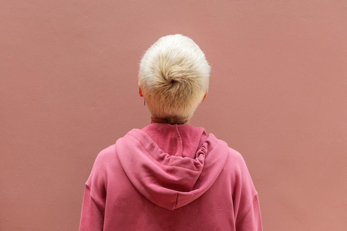 Cool girl wearing a pink hoodie