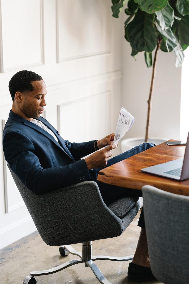 Black businessman reading a newspaper