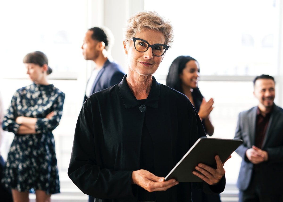 Happy empowering businesswoman holding a digital tablet