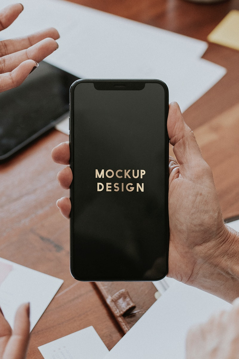 Woman holding a mobile phone screen mockup