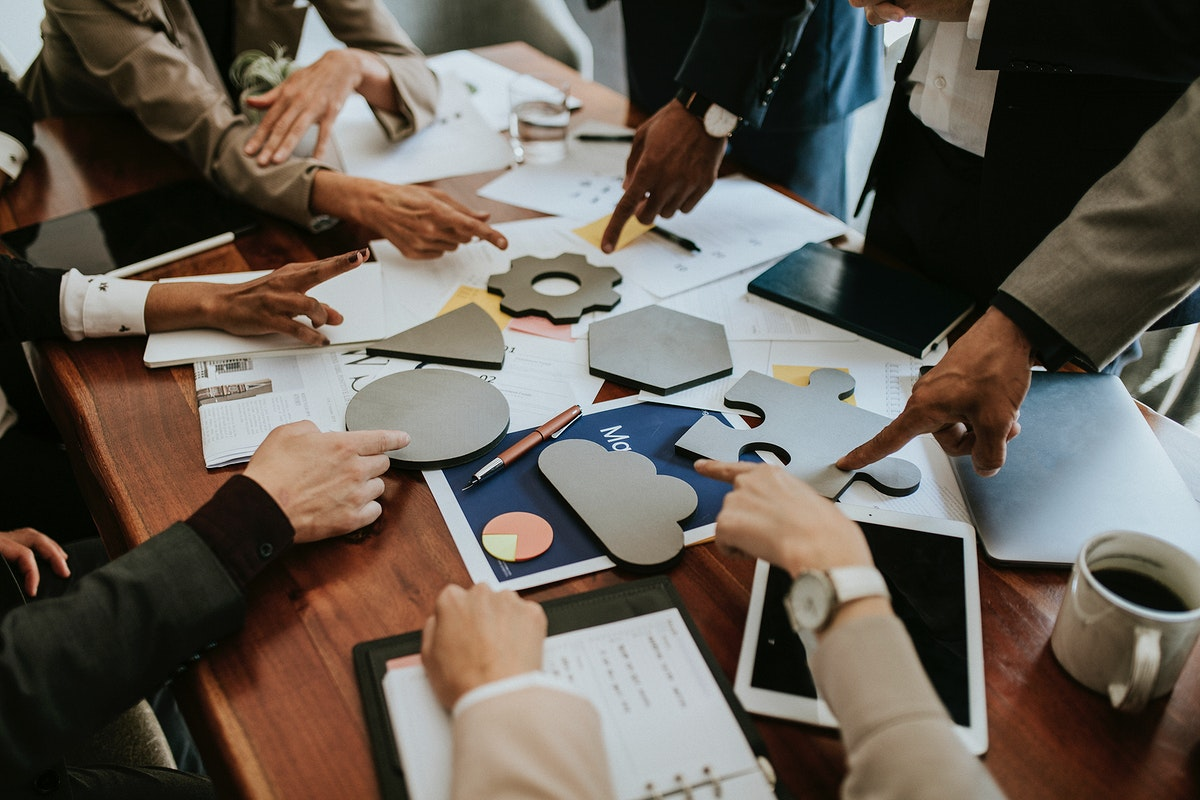 Business people solving a puzzle in a meeting