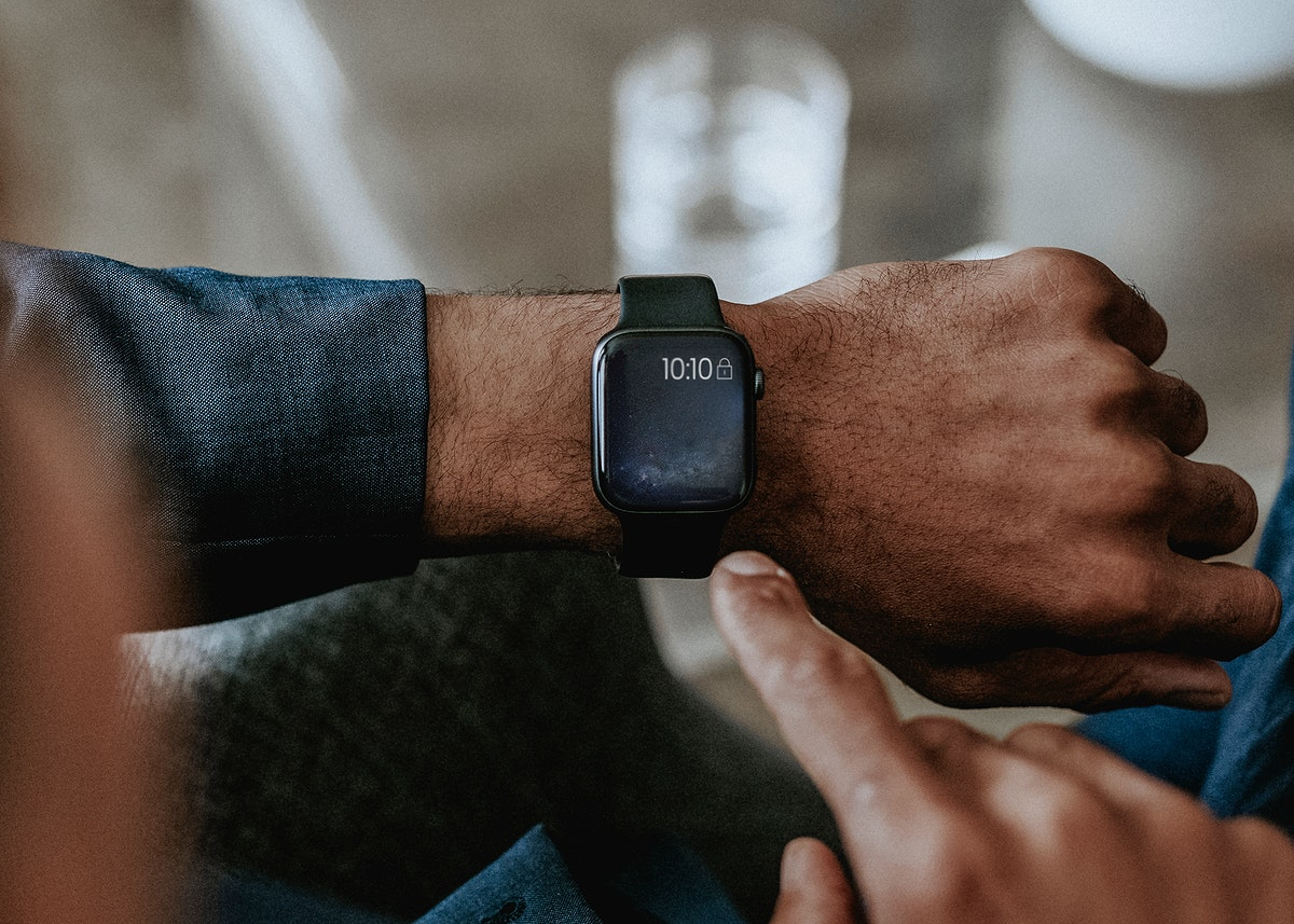 Man checking a time on his smartwatch
