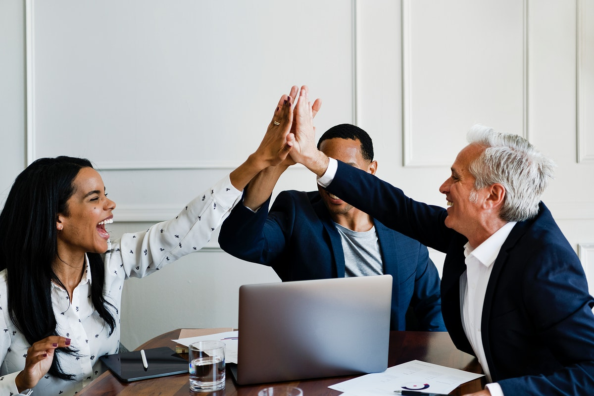 Successful business people doing a high five