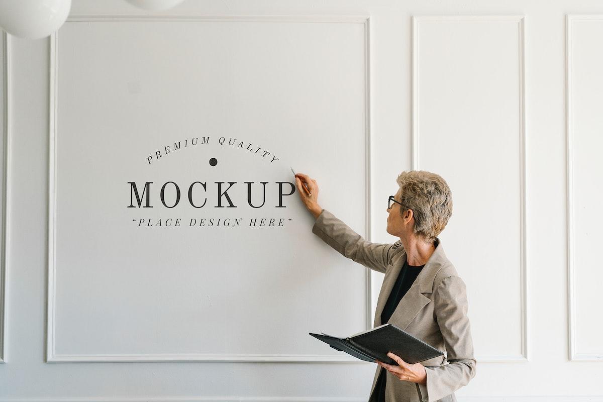 Blonde aged woman having a presentation mockup