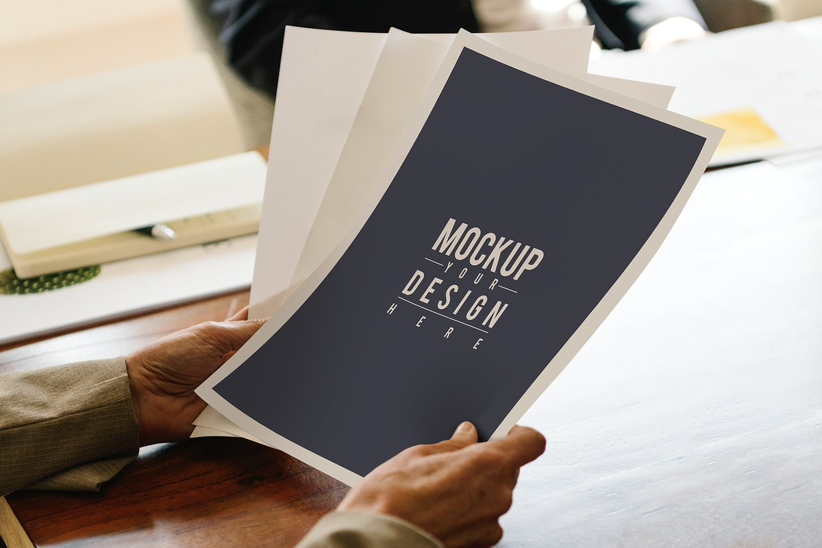 Businesswoman holding paper mockups in the meeting room