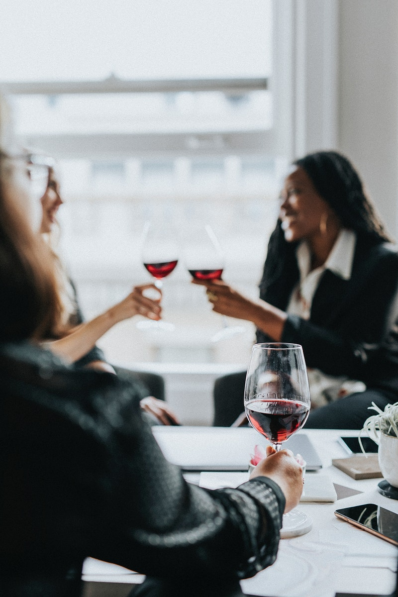 Black businesswoman toasting in the office