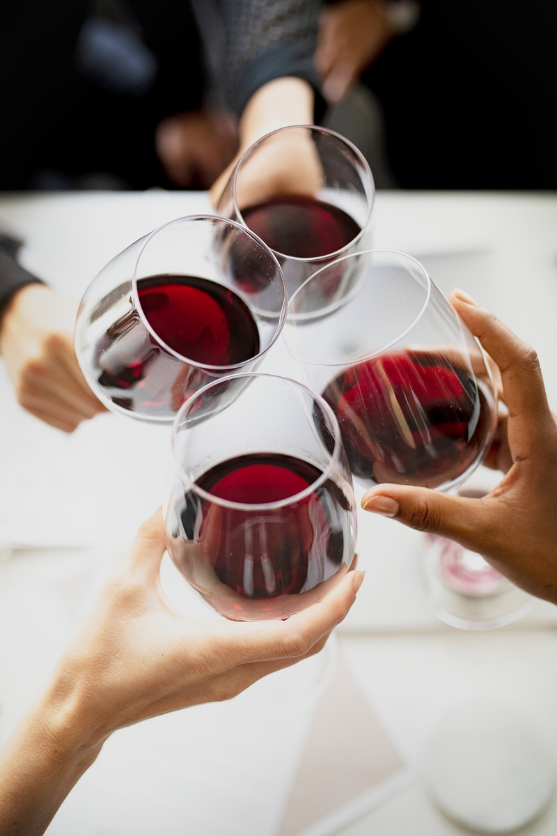 Business people toasting red wine in the office