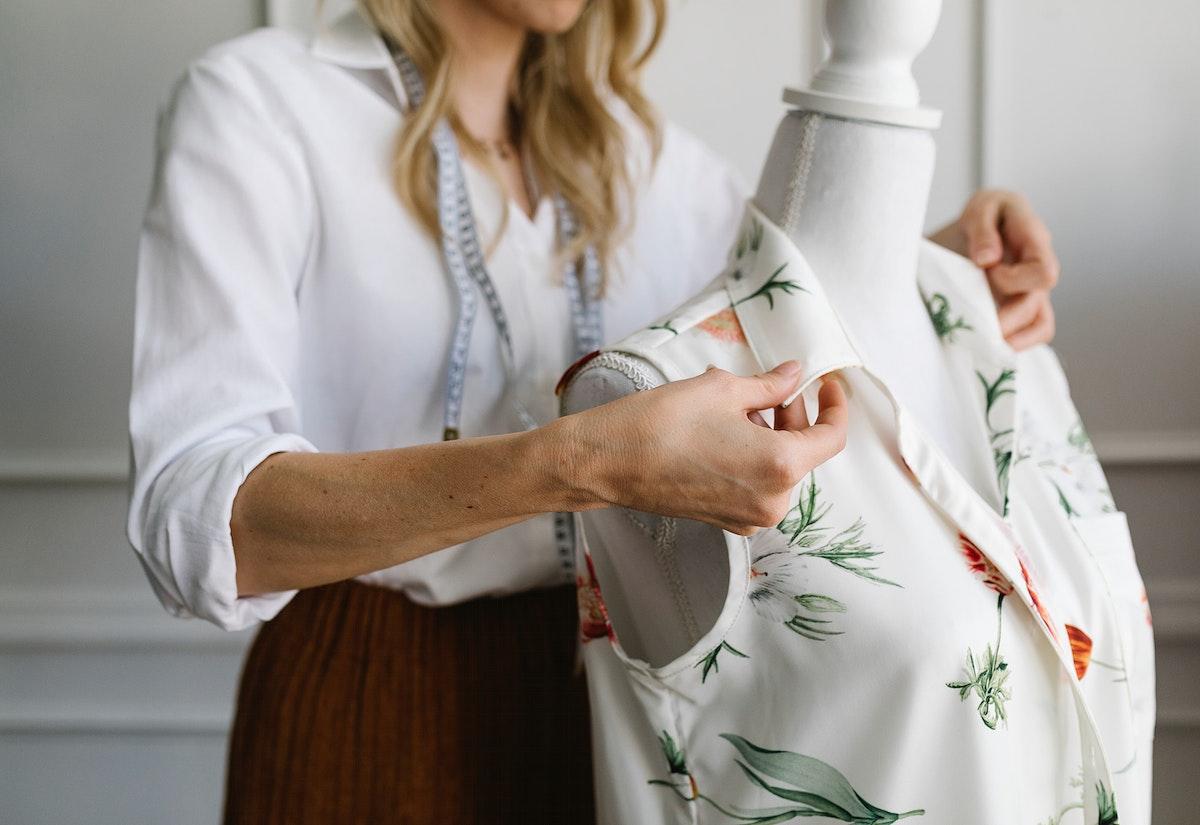 Fashion designer using a pinnable mannequin