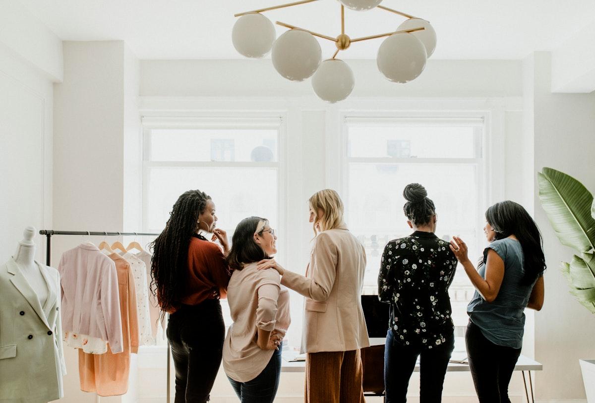 Happy female fashion designers working together