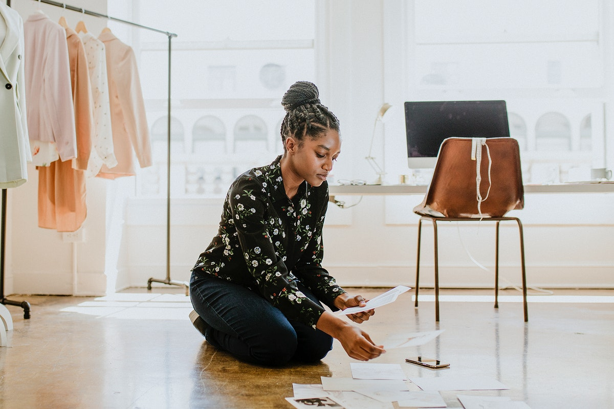 Young female designer in a boutique