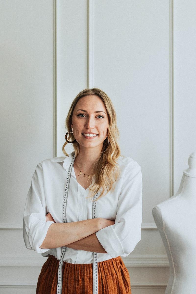 Designer wearing a measuring tape around her neck
