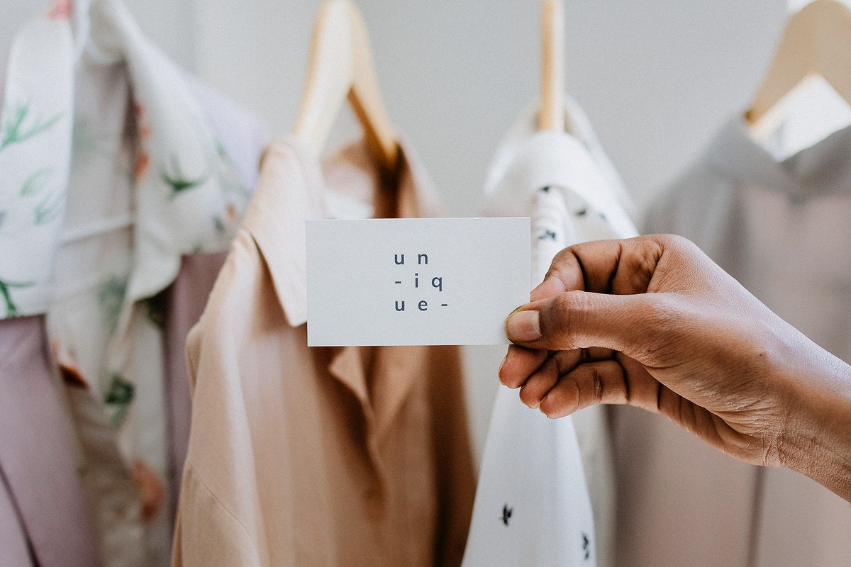 Hand holding business card at a boutique
