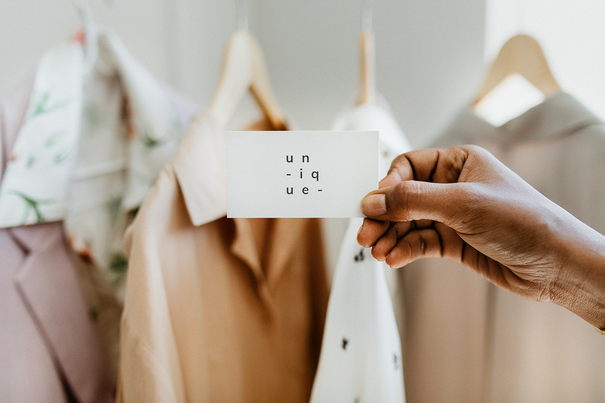 Hand holding business card in a boutique