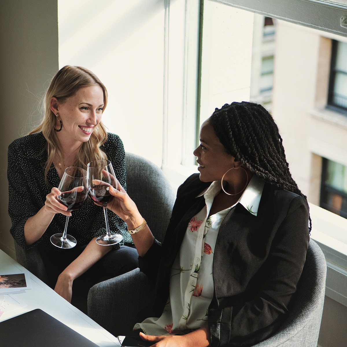 Happy businesswomen toasting in the office