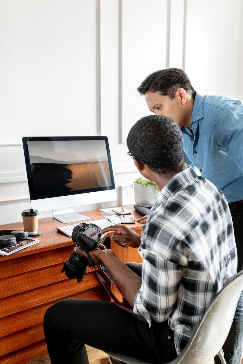 Photographer checking photos on computer