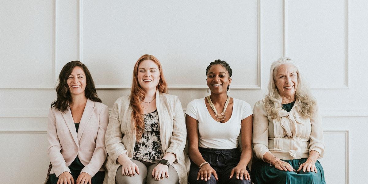 Empowering gorgeous businesswomen sitting together