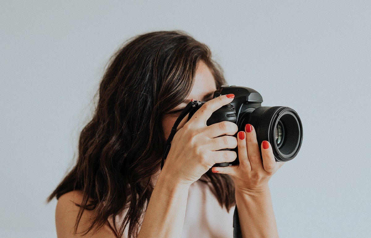 Female photographer holding digital camera