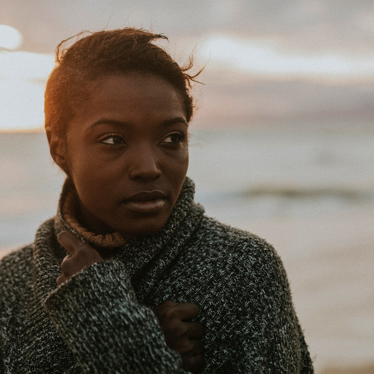 Black woman at the beach during sunset