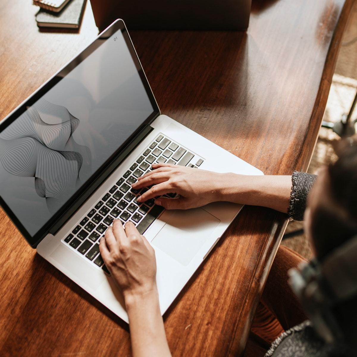 Businesswoman using a laptop screen mockup