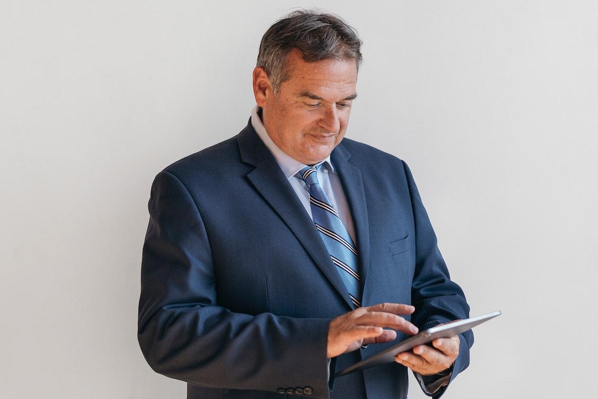 Businessman using a digital tablet mockup