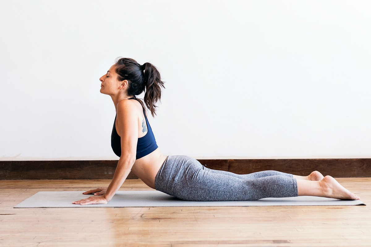Sporty woman doing yoga in the room