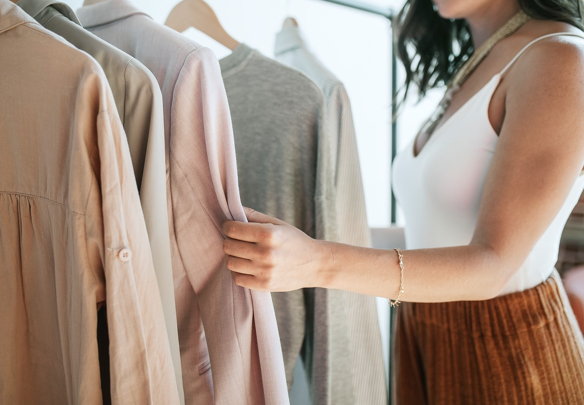 Fashion stylist working with clothes
