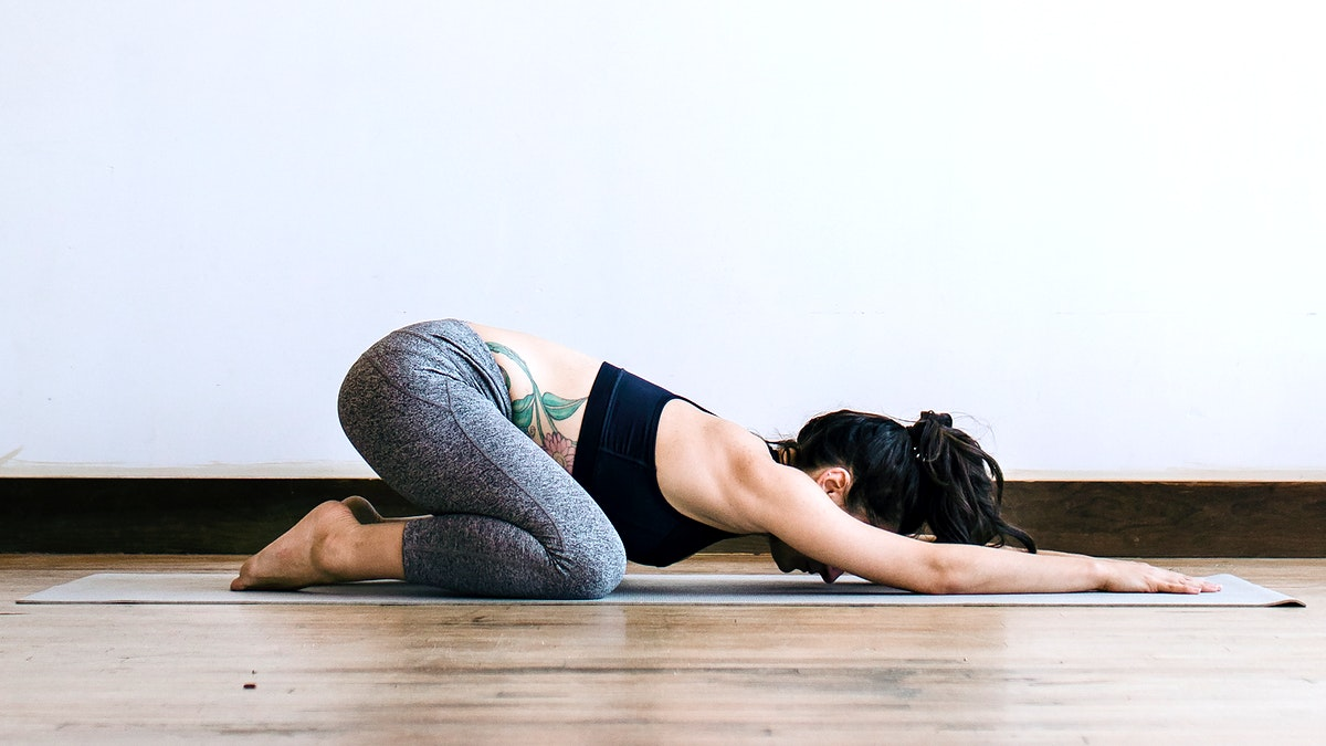 Active woman doing yoga in the room