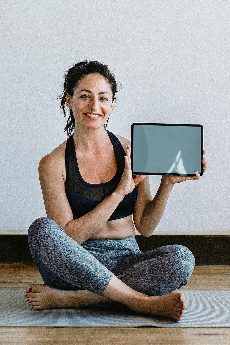 Yoga instructor showing a digital tablet mobile phone wallpaper