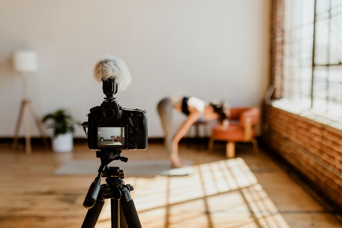 Yogini filming herself at a studio