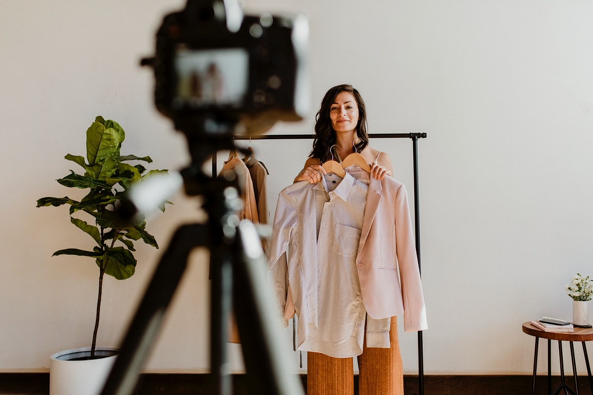 Cheerful female vlogger recording content for her fashion channel