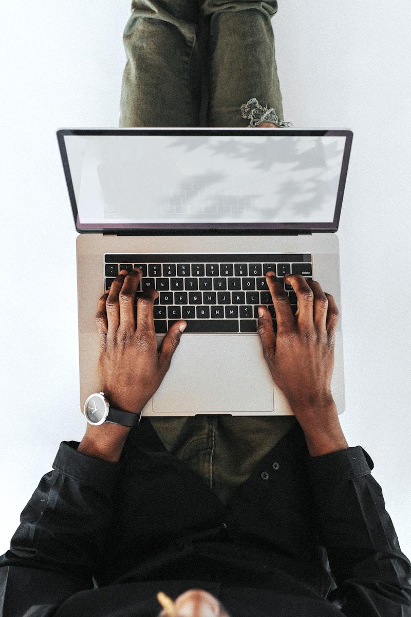 Man using a laptop device