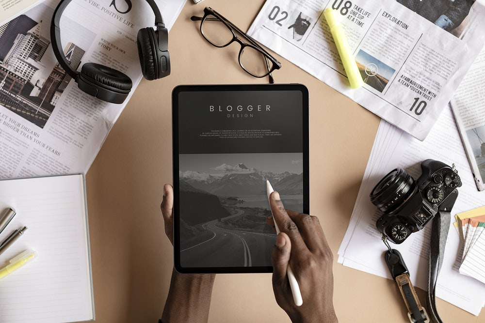 Black woman blogging on a digital tablet mockup