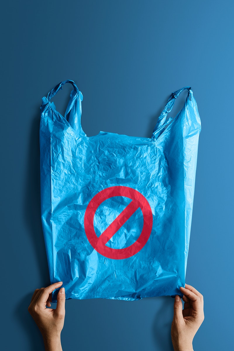 Woman holding a blue plastic bag mockup with a ban sign