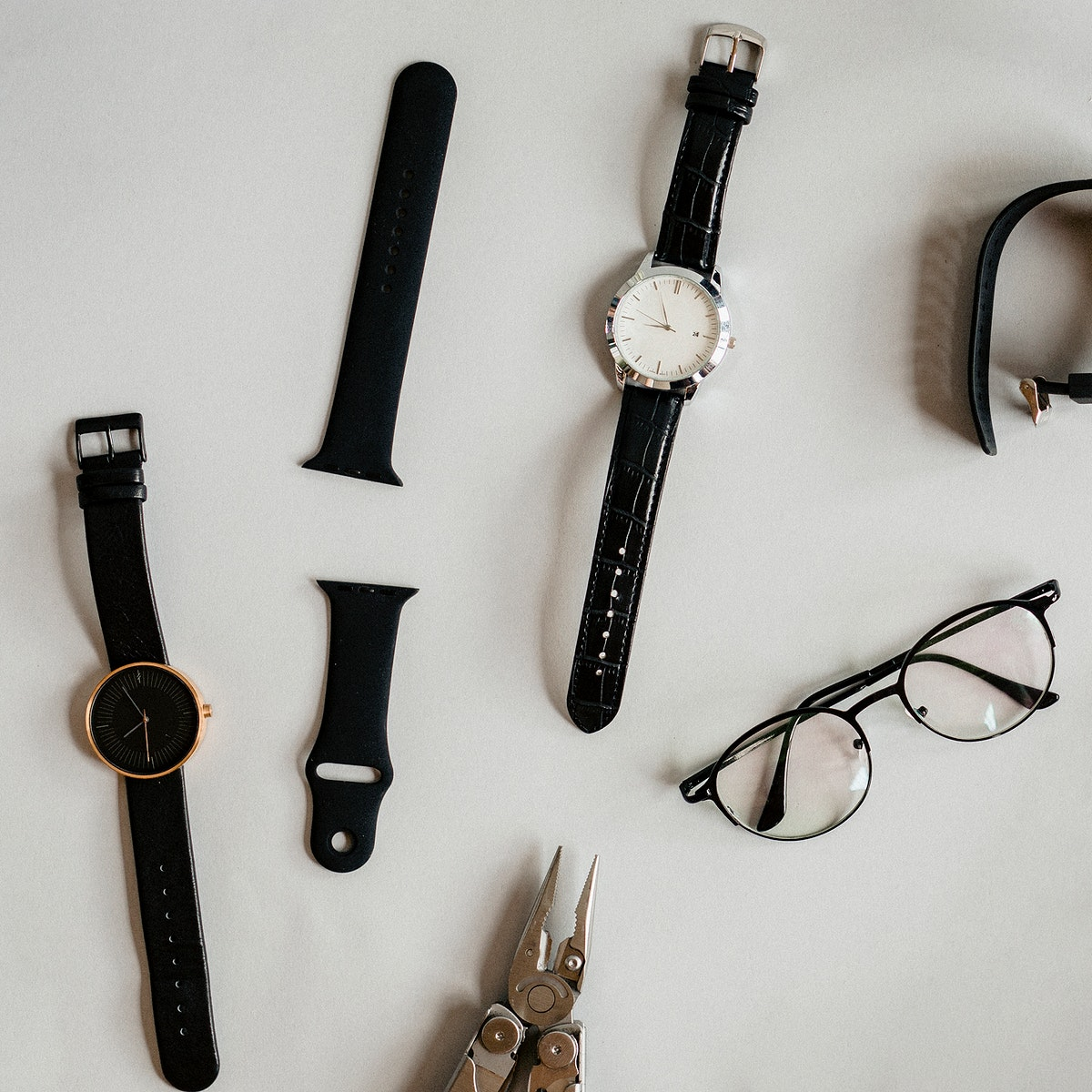 Watches and a plier on a table