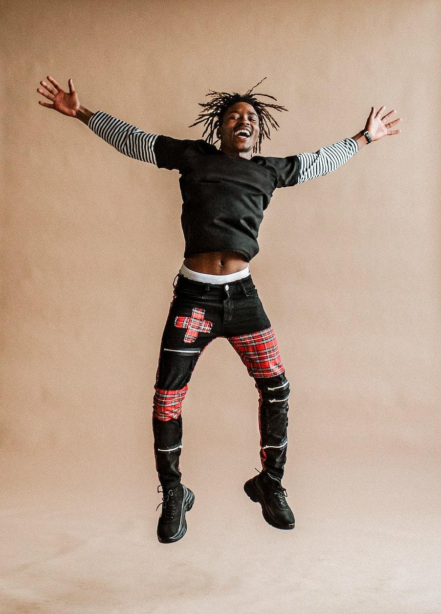 Joyful black man jumping for joy