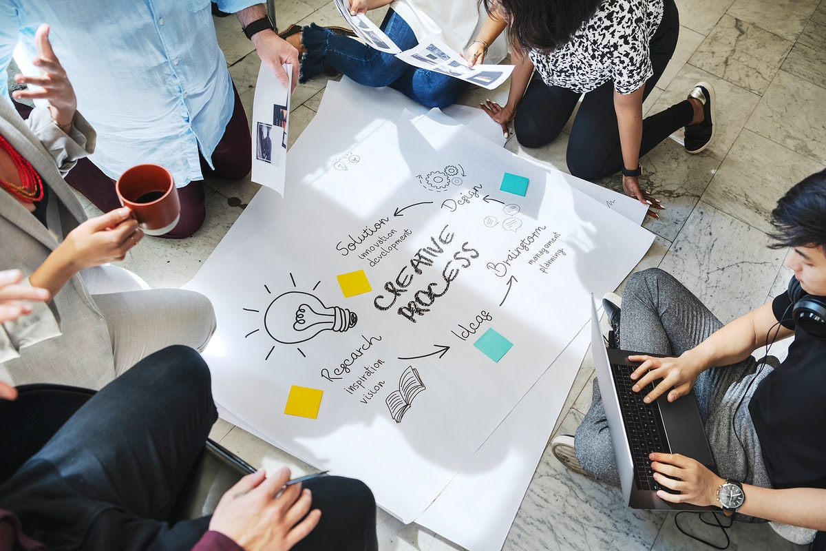 Business people brainstorming management process on paper