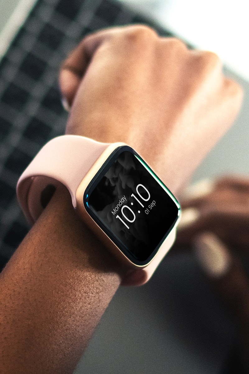 Young woman wearing a smartwatch mockup
