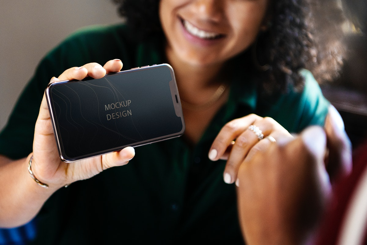 Woman showing a blank phone mockup