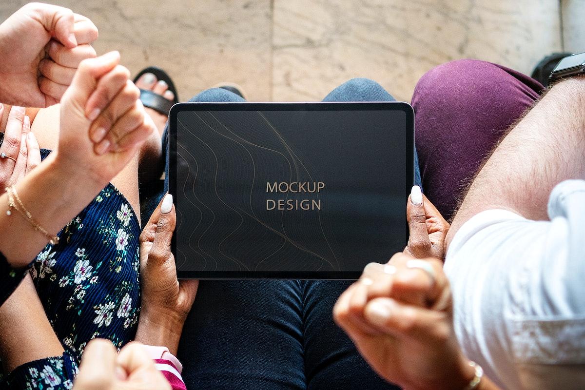 Hands holding digital tablet mockup